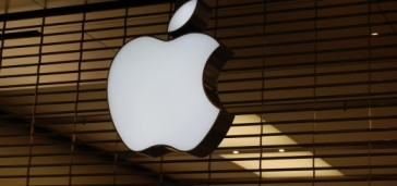 The Apple logo sign on wooden blinds